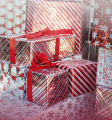 Christmas holiday gifts wrapped with ribbon