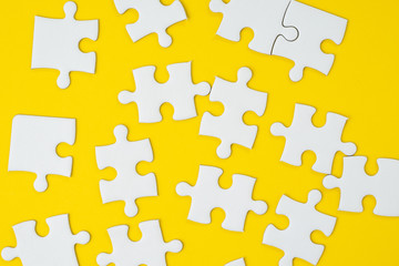 Business strategy for success metaphor or various solutions to solve problem concept, jigsaw puzzle pieces on yellow background