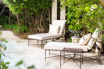 Patio two lounge chairs in outdoor spring green garden in backyard porch of home zen, plants, reclining furniture, nobody in Florida tropical