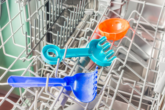 Childrens sand toys lie in the dishwasher