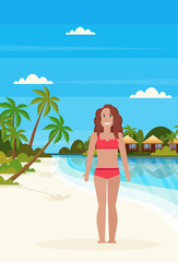 bikini woman on tropical island with villa bungalow hotel on beach seaside green palms landscape summer vacation concept flat vertical