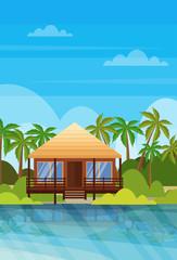 tropical island villa bungalow hotel on beach seaside green palms landscape summer vacation concept flat vertical