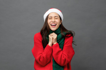 Excited woman in red Christmas sweater