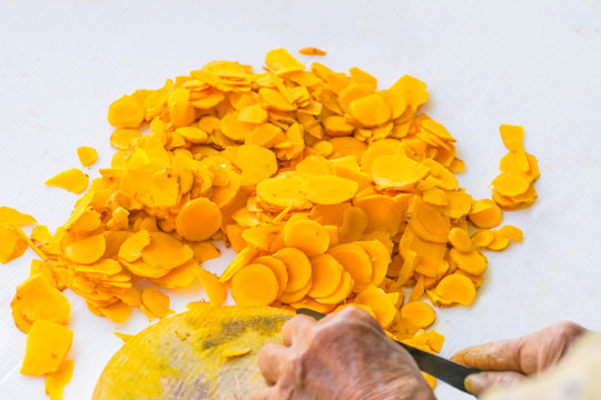 Abstract soft focus farmer practice cut slice of Zingiber,Turmeric root, Cassumunar ginger, Bengal root,Zingiberaceae, turmeric for drying.The local food and Thai herb in Thailand.