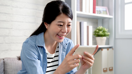 happy lady holding mobile phone watching comedy