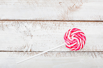 Red and white striped lollipop, table high angle view