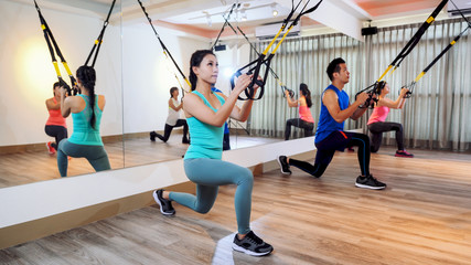 people performing TRX suspension training