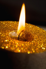 Gold christmas candle with glitter