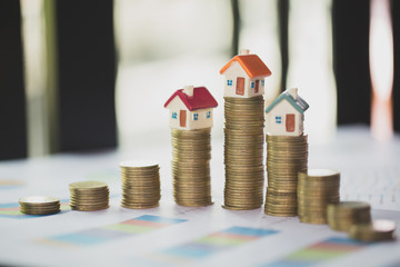 Mini house on stack of coins, Real estate investment, Save money with stack coin, Business growth investment and financial, Mortgage concept.