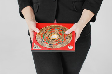 Chinese compass Lopan for Feng Shui technique in female hands isolated Wall mural
