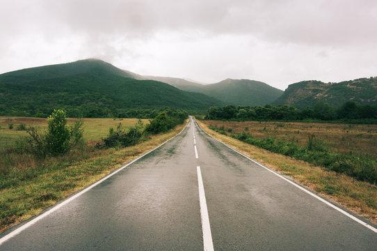 Wet asphalt road at rainy day