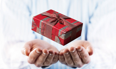 Concept of xmas or celebration with present box in male palms. M