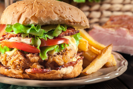 Chickenburger with bacon, tomato, cheese and lettuce