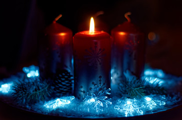Advent wreath in red gold candles with snow as background and not yet lit candles