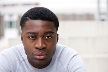 Close up young black man staring