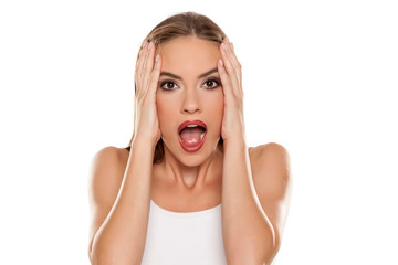 Beautiful shocked girl on white background