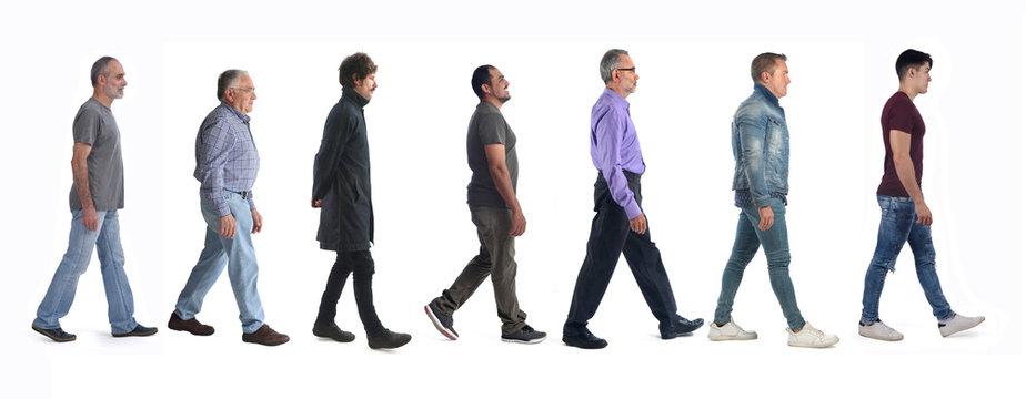 large group of men walking on white