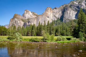 merced river in yosemite Park with rocks
