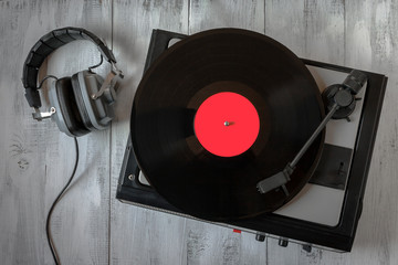 Old record player for vinyl records and headphones