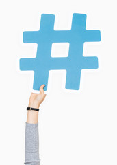 Hand raised holding hashtag icon