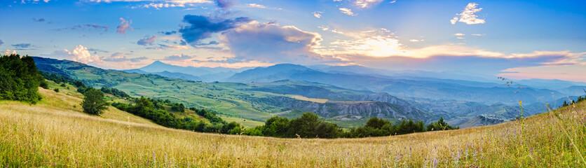 Sunset in mountains panorama