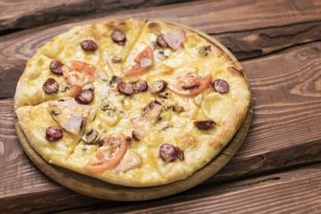 Pizza on a dark wooden background.