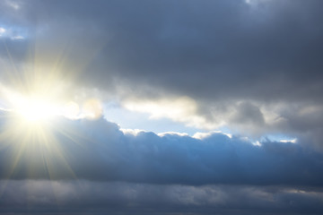 Rays of light shining through dark clouds, dramatic sky with cloud.