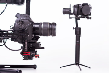 Systems stabilization video camera and lens on steady equipment support such as gimbal steady or stabilized. White background