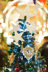 Image of decorated Christmas spruce with clock, blue balls in store