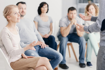 Woman talking with man during therapy for couples with problems
