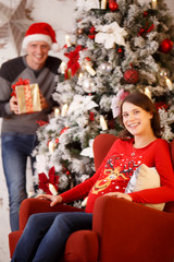 Christmas photo of happy married couple waiting for child