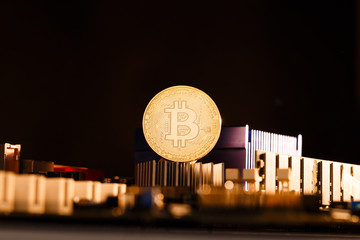 Photo of virtual currency, bitcoin and processor on orangebackground