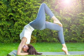 pretty adult woman doing yoga