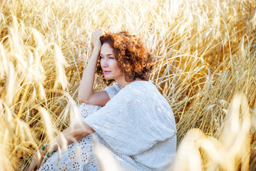 middle aged beautiful smiling woman in wheat field
