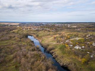 Aerial: Tiasmyn canyon near Kamianka town, Ukraine, autumn time