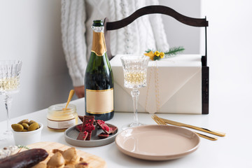 New Year champagne and vintage french glasses. Food for Christmas selebration. Happy winter holidays. Presents for Christmastime.