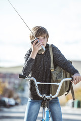 Portrait of a boy on a bicycle in park outdoors