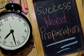 Success Need Preparation on phrase colorful handwritten on chalkboard and alarm clock with motivation, inspiration and education concepts. Table background