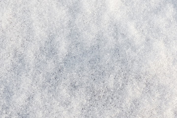 Background of crystal snow. White fresh snowy texture.