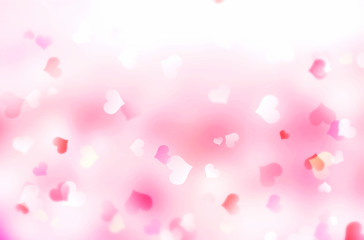 Valentine's day blurred hearts bokeh background.