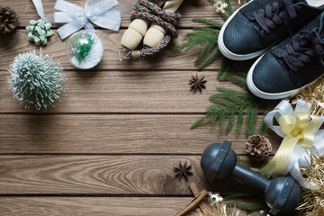 Fitness and Healthy Christmas sport composition. Top view of sport shoes, dumbbells and Christmas ornaments special for Merry Christmas and Happy new year fitness healthy lifestyle concept.