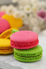 Colorful macaroons on wooden table. Sweet dessert