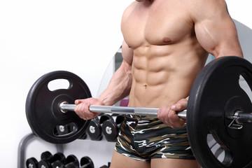 Bodybuilder exercising in the gym
