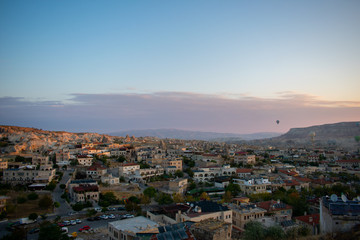 Aerial view on Sunrise over Cappadocia. Balloons flying against blue sky. Goreme most popular place in Turkey