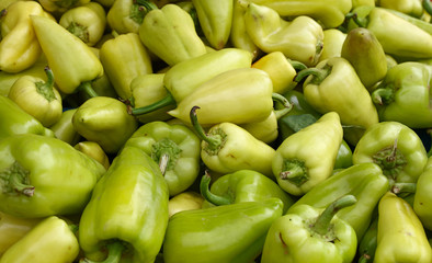 Close up fresh green and yellow bell peppers