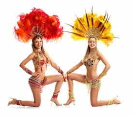 Brazilian women dancing samba over white background