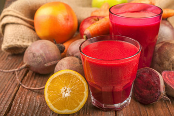 Smoothie from beetroot, lemon, grapefruit, carrots and apples. Fresh, healthy and homemade.