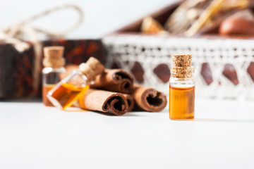 Essential oil cinnamon in glass bottle. Spa concept