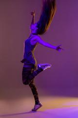 Modern style dancer posing on studio background. Color filters