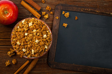 Apple Cinnamon Granola Back to school. Education background concept with copyspace. Selective focus.